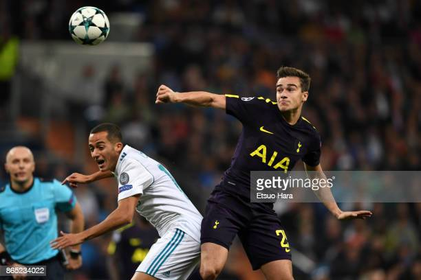 Harry Winks of Tottenham Hotspur and Lucas Vazquez of Real Madrid compete for the ball during the UEFA Champions League group H match between Real...