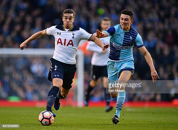 Harry Winks of Tottenham Hotspur and Luke O'Nien of Wycombe Wanderers compete for the ball during the Emirates FA Cup Fourth Round match between...