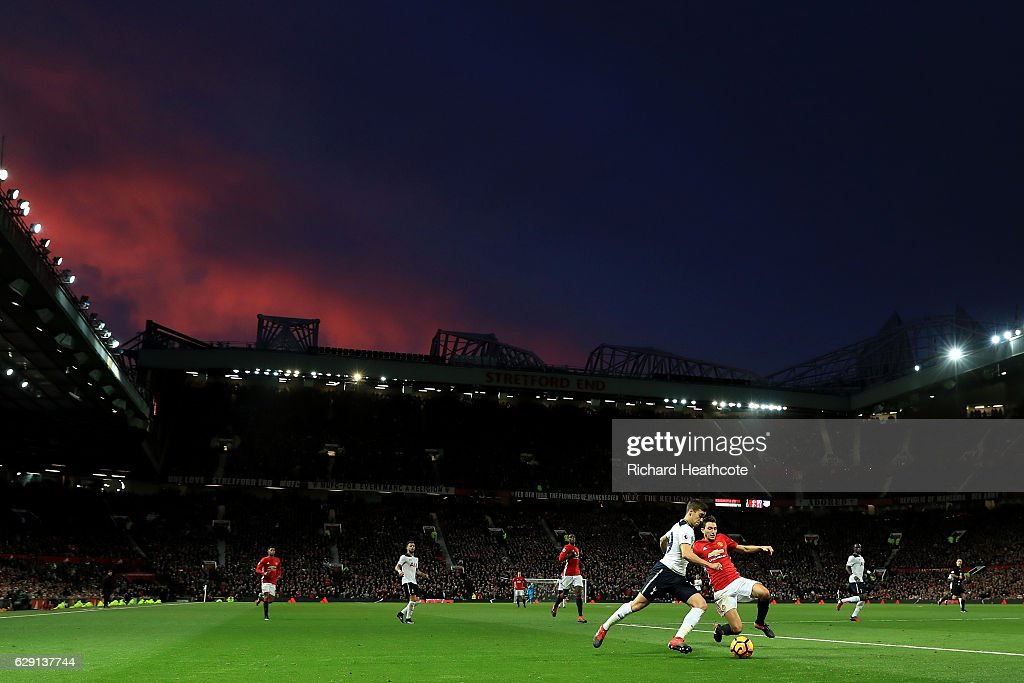 Harry Winks of Tottenham Hotspur and Matteo Darmian of Manchester United compete for the ball during the Premier League match between Manchester United and Tottenham Hotspur at Old Trafford on December 11, 2016 in Manchester, England.