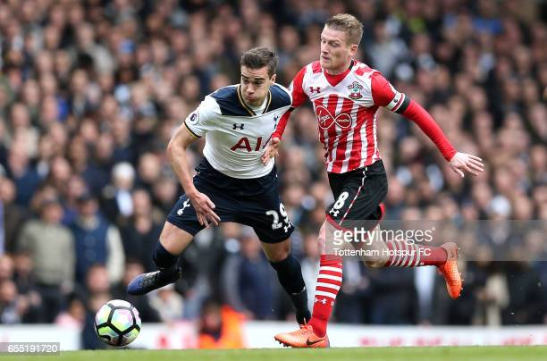 Harry Winks of Tottenham Hotspur and Steven Davis of Southampton battle for possession during the Premier League match between Tottenham Hotspur and...