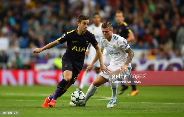 Harry Winks of Tottenham Hotspur and Toni Kroos of Real Madrid during the UEFA Champions League group H match between Real Madrid and Tottenham...