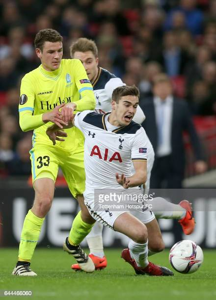 Harry Winks of Tottenham Hotspur battles with Louis Verstraete of Gent during the UEFA Europa League Round of 32 second leg match between Tottenham...