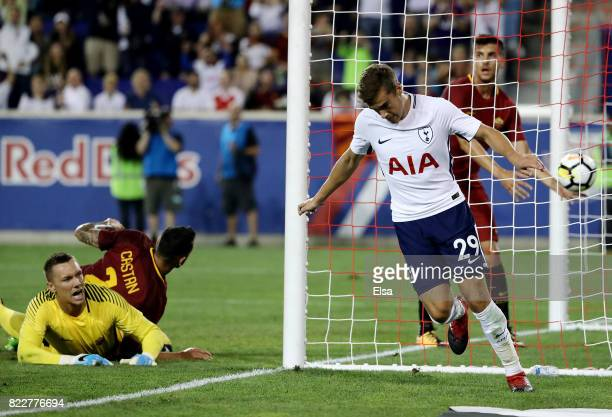 Harry Winks of Tottenham Hotspur celebrates his goal in the second half as Lukasz Skorupski of Roma reacts during the International Champions Cup on...