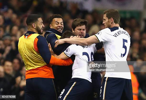 Harry Winks of Tottenham Hotspur celebrates scoring his sides first goal with Mauricio Pochettino Manager of Tottenham Hotspur and his Tottenham...