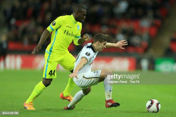 Harry Winks of Tottenham Hotspur holds off Anderson Esitia of Gent during the UEFA Europa League Round of 32 second leg match between Tottenham...
