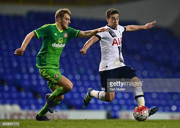 Harry Winks of Tottenham Hotspur holds off Martin Smith of Sunderland during the Barclays U21 Premier League match between Tottenham Hotspur U21 and...