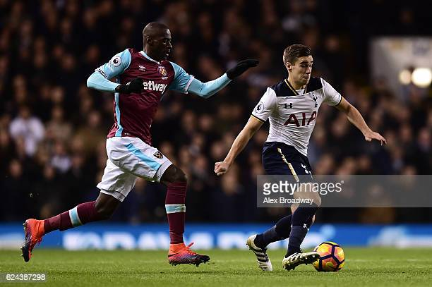 Harry Winks of Tottenham Hotspur is chased by Cheikhou Kouyate of West Ham United during the Premier League match between Tottenham Hotspur and West...