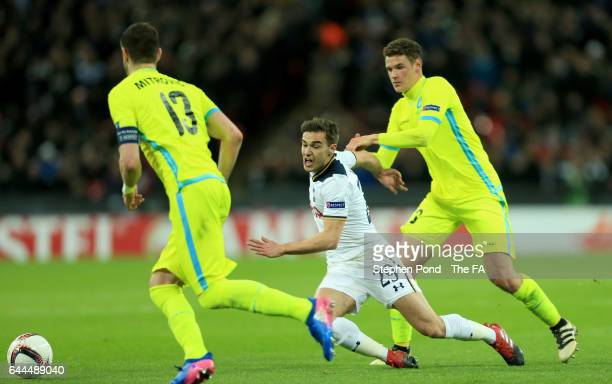 Harry Winks of Tottenham Hotspur is fouled by Louis Verstraete of Gent during the UEFA Europa League Round of 32 second leg match between Tottenham...