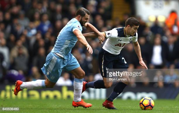Harry Winks of Tottenham Hotspur is put under pressure by Erik Pieters of Stoke City during the Premier League match between Tottenham Hotspur and...