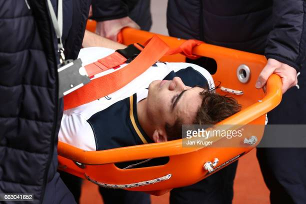 Harry Winks of Tottenham Hotspur is stretchered off during the Premier League match between Burnley and Tottenham Hotspur at Turf Moor on April 1...