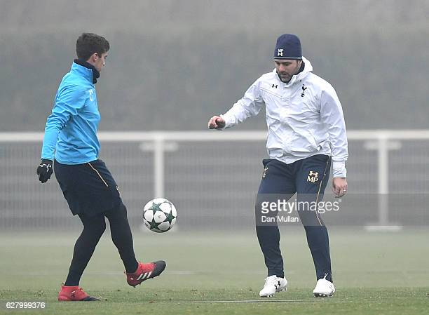 Harry Winks of Tottenham Hotspur passes to Mauricio Pochettino Manager of Tottenham Hotspur during the Tottenham Hotspur FC training session at the...