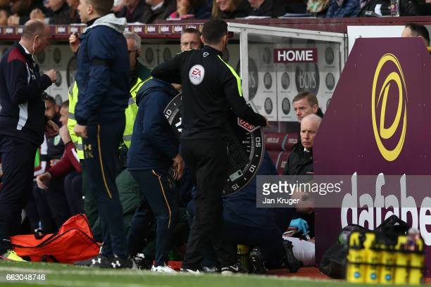 Harry Winks of Tottenham Hotspur receives treatment from the medical team on the sidelines during the Premier League match between Burnley and...