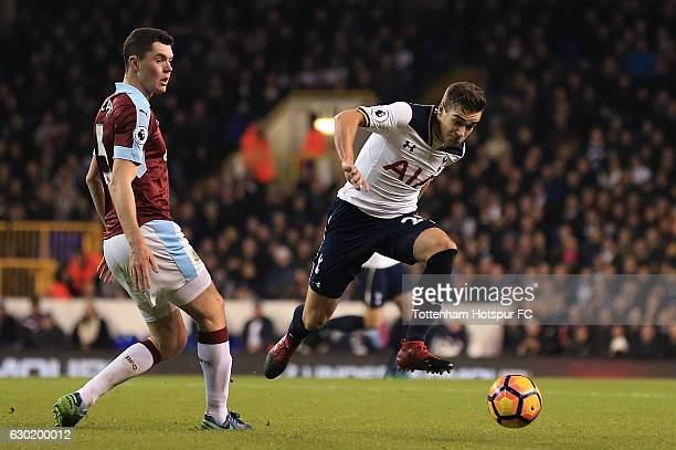 Harry Winks of Tottenham Hotspur takes the ball past Michael Keane of Burnley during the Premier League match between Tottenham Hotspur and Burnley...