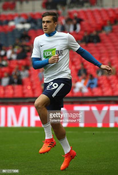 Harry Winks of Tottenham Hotspur warms up prior to the Premier League match between Tottenham Hotspur and AFC Bournemouth at Wembley Stadium on...