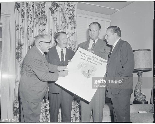 Harry Wismer noted TV and radio sportscaster receives from Barry Faris editorinchief of International News Service a king size greeting card at a...