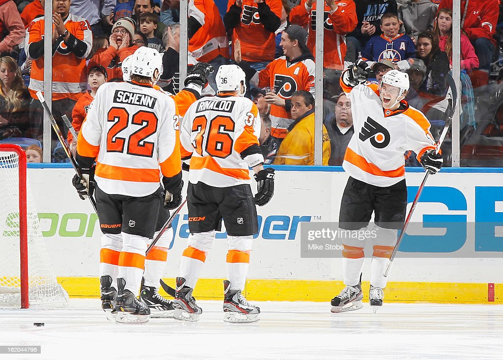 Harry Zolnierczyk #12 of the Philadelphia Flyers celebrates his third period goal with teammates <a gi-track='captionPersonalityLinkClicked' href=/galleries/search?phrase=Luke+Schenn&family=editorial&specificpeople=4254202 ng-click='$event.stopPropagation()'>Luke Schenn</a> #22 and Zac Rinaldo #36 during the game against the New York Islanders at Nassau Veterans Memorial Coliseum on February 18, 2013 in Uniondale, New York.