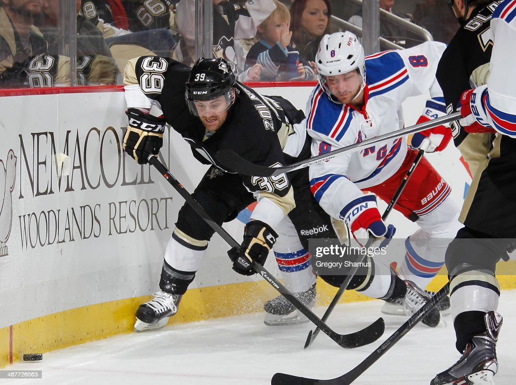 Harry Zolnierczyk #39 of the Pittsburgh Penguins battles for position against Kevin Klein #8 of the New York Rangers on February 7, 2014 at Consol Energy Center in Pittsburgh, Pennsylvania.