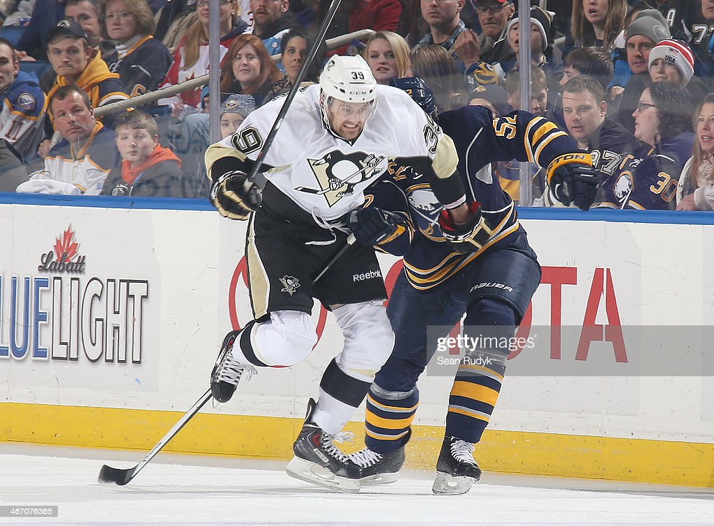 Harry Zolnierczyk #39 of the Pittsburgh Penguins gets caught up in the stick of <a gi-track='captionPersonalityLinkClicked' href=/galleries/search?phrase=Alexander+Sulzer&family=editorial&specificpeople=673531 ng-click='$event.stopPropagation()'>Alexander Sulzer</a> #52 of the Buffalo Sabres at First Niagara Center on February 5, 2014 in Buffalo, New York. (Photo by Sean Rudyk/Getty Images). Pittsburgh defeated Buffalo 5-1.