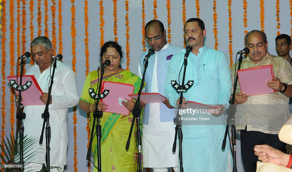 from left MLA Harsh Singh , Lalita Yadav ,Vishwas Sarang,Sanjay Pathak , Surya Narayan Meena taking oath as a state minister minister at Raj Bhavan on June 30, 2016 in Bhopal, India. Madhya Pradesh Chief Minister Shivraj Singh Chouhan expanded his cabinet inducting nine new ministers, four of cabinet rank and five ministers of state.