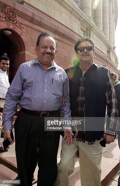 Harsh Vardhan with Shatrughan Sinha on the first day of the second part of the Budget session at Parliament House on April 20 2015 in New Delhi India...