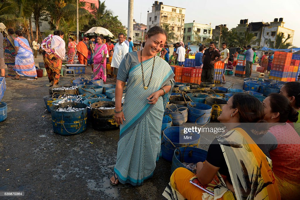Harsha Tapke, a fisherwoman from Versova, a small fishing village started her own business of selling fish to keep her sense of self intact on November 18, 2015 in Mumbai, India. Tapke, 45 belongs to the Koli, Mumbais fisherfolk community. Versova village is home to around 15,000 Kolis and are facing an existential crisis amid the depleting quality of water, dead fishes and land sharks. While the Koli community settled in the area long before modern Mumbai grew around these small villages, the members of this fishing village are considered expendable anachronisms by real estate developers who covet their valuable sea-facing land.