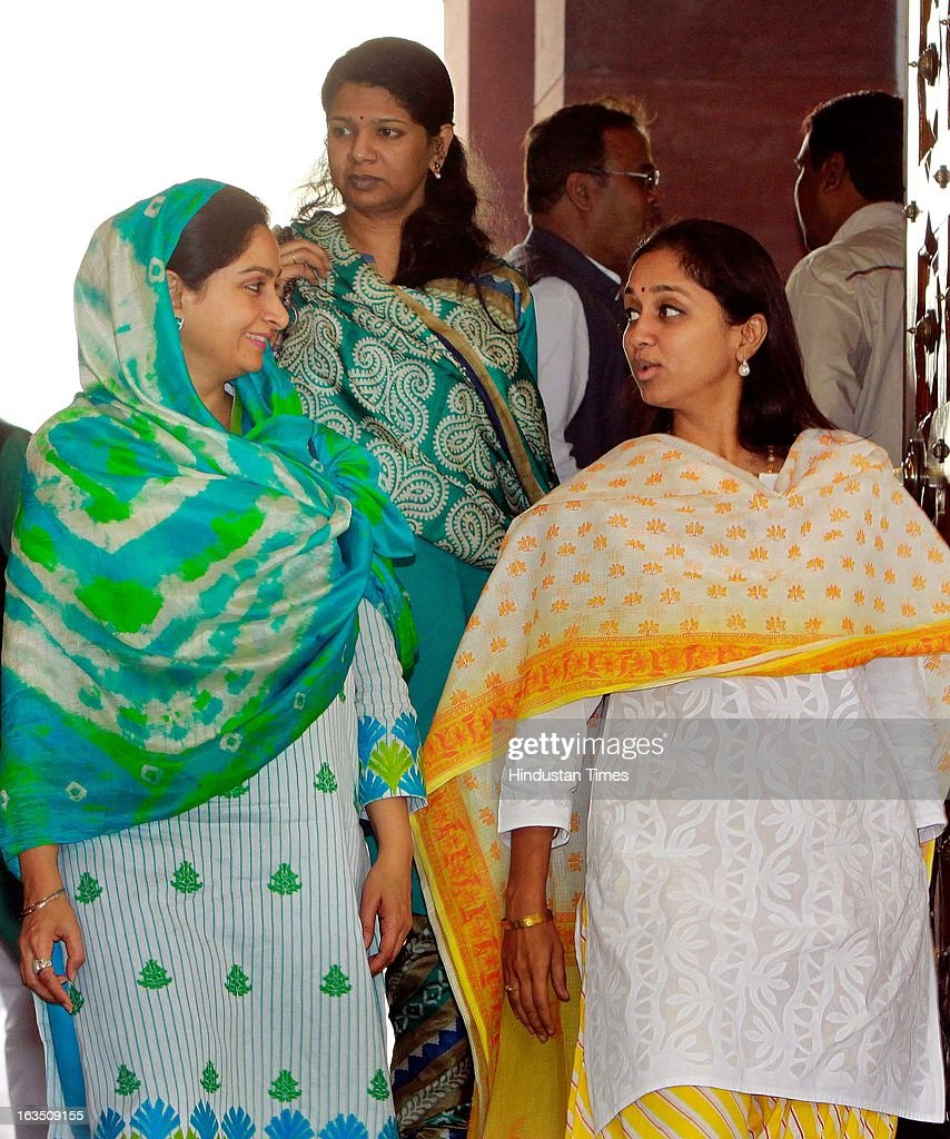 Harsimrat Kaur Badal member of parliament for Bathinda and wife of Deputy Chief Minister Sukhbir Singh Badal (L), Kanimozhi Karunanidhi Member of Parliament from Tamil Nadu daughter of DMK chief Tamil Nadu Karunanidhi (C), Supriya Sule MP 15th Lok Sabha and daughter of the President of the Nationalist Congress Party Sharad Pawar (R) after attending ongoing parliament budget session on March 11, 2013 in New Delhi, India.