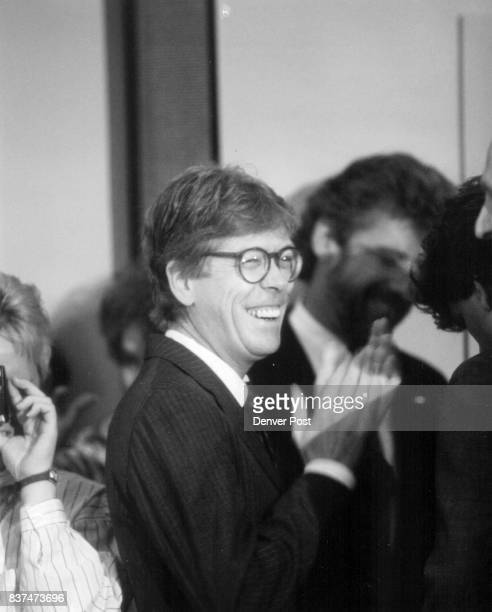 Hart campaign manager Bill Dixon laughs it up just prior to the start of the press conference at which Gary Hart announced he would no longer seek...