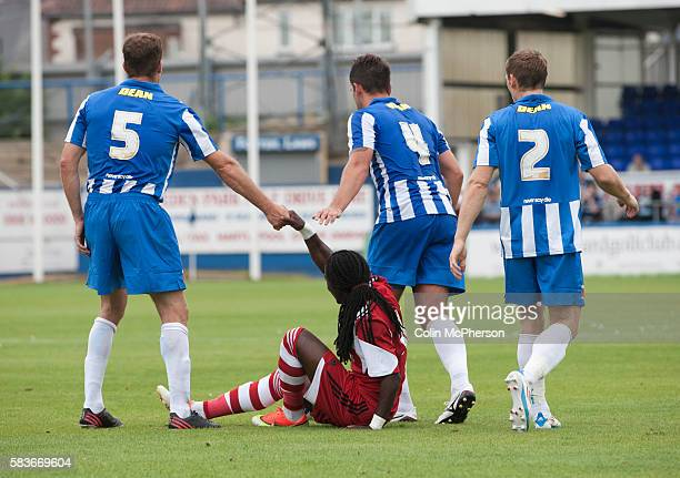 Hartlepool United defenders Sam Collins Simon Walton and Neil Austin offering a helping hand to visiting forward Marvin Emnes during the firsthalf at...