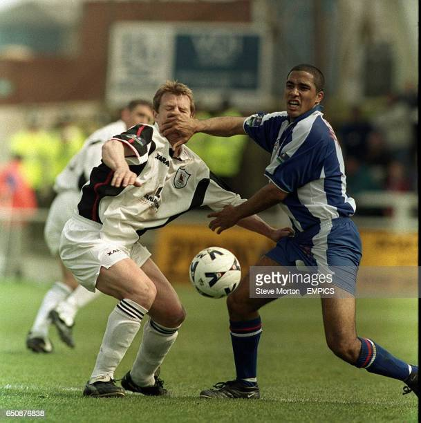 Hartlepool United's Chris Westwood puts a hand in the face of Darlington's Marco Gabbiadini whilst battling for the ball