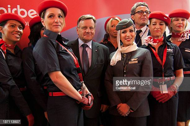 Hartmut Mehdorn CEO of Air Berlin poses together with stewardesses of the airlines Air Berlin and Etihad Airways at the launch of Air Berlin service...