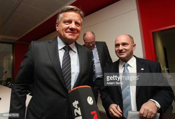 Hartmut Mehdorn former chief executive of Air Berlin and Deutsche Bahn and German Transport Ministry State Secretary Rainer Bomba leave at a news...