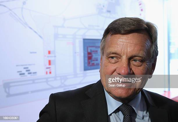 Hartmut Mehdorn head of the management board of Berlin's new Willy Brandt Berlin Brandenburg International Airport stands next to a map of the new...