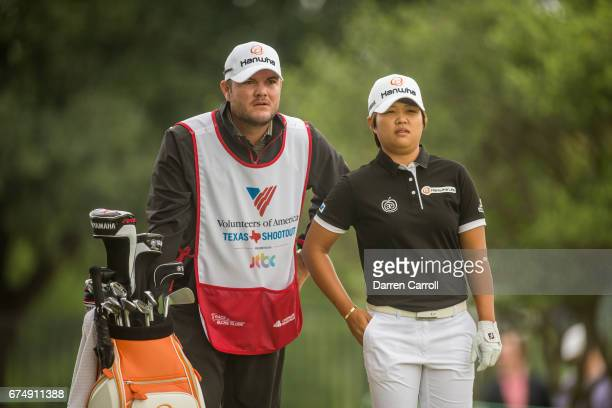 Haru Nomura of Japan discusses her tee shot strategy at the second hole with her caddie during the third round of the Volunteers of America North...