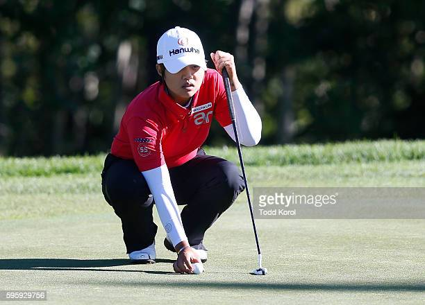 Haru Nomura of Japan lines up her putt on the 4th green during the second round of the Canadian Pacific Women's Open at Priddis Greens Golf and...
