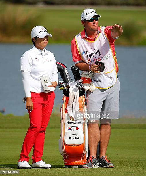 Haru Nomura of Japan lines up her second shot on the ninth hole during the second round of the Pure Silk Bahamas LPGA Classic at the Ocean Club Golf...