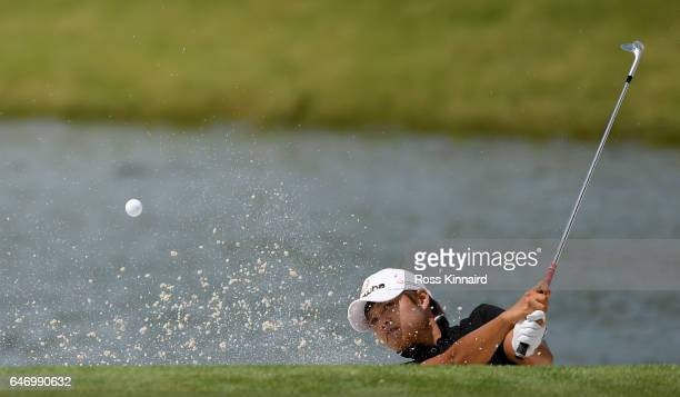 Haru Nomura of Japan plays her second shot on the par three 15th hole during the first round of the HSBC Women's Champions on the Tanjong course at...
