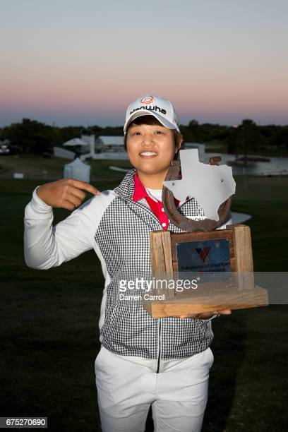 Haru Nomura of Japan poses with the champion's trophy following her playoff victory over Cristie Kerr in the final round of the Volunteers of America...