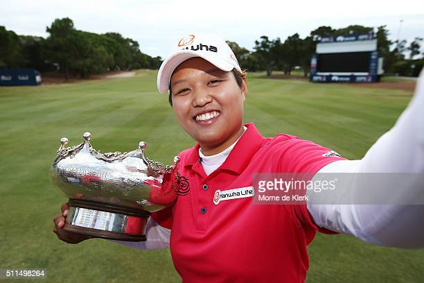 Haru Nomura of Japan pretends to take a selfie with the trophy after she won the Women's Australian Open on day four of the ISPS Handa Women's...