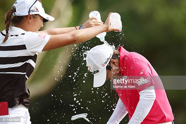 Haru Nomura of Japan runs away from Lydia Ko of New Zealand as Ko tries to dump water on her head in celebration after Nomura won the Women's...