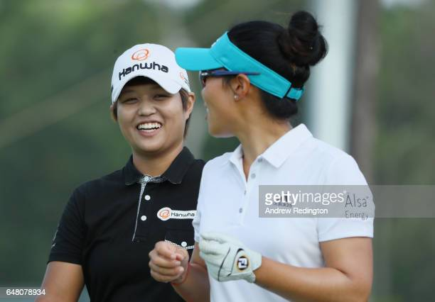 Haru Nomura of Japan shares a joke with Danielle Kang of the USA during the final round of the HSBC Women's Champions on the Tanjong Course at...