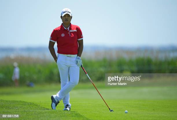 Haru Nomura of Japan waits in the fairway to hit her second shot on the third hole during the first round of the ShopRite LPGA Classic presented by...