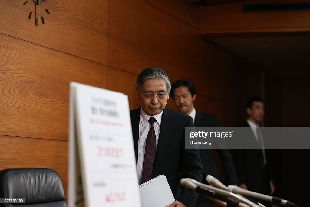 Haruhiko Kuroda, governor of the Bank of Japan (BOJ), arrives at a news conference at the central bank's headquarters in Tokyo, Japan, on Friday, Jan. 29, 2016. Kuroda sprung another surprise on investors by adopting a negative interest-rate strategy to spur banks to lend in the face of a weakening economy. Photographer: Tomohiro Ohsumi/Bloomberg via Getty Images