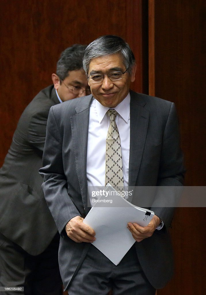 Haruhiko Kuroda, governor of the Bank of Japan (BOJ), arrives for a group interview at the central bank's headquarters in Tokyo, Japan, on Wednesday, April 10, 2013. Kuroda said that the central bank will take all measures necessary to meet a 2 percent inflation target even as he indicated policy adjustments are unlikely every month. Photographer: Tomohiro Ohsumi/Bloomberg via Getty Images