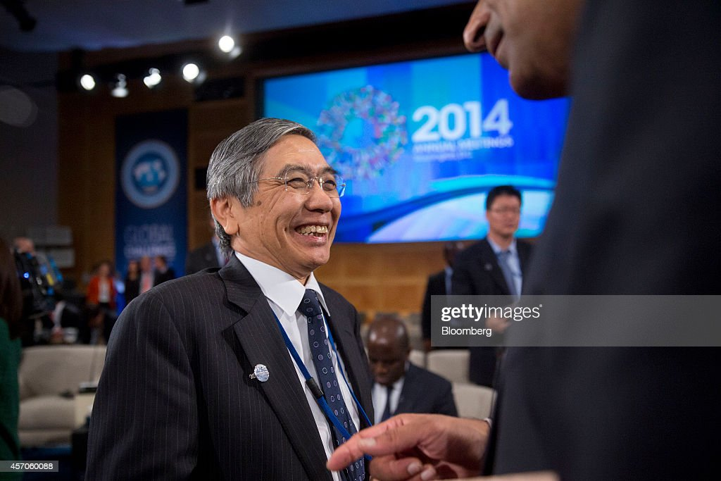Haruhiko Kuroda, governor of the Bank of Japan (BOJ), laughs during an International Monetary Fund Committee (IMFC) governors meeting at the International Monetary Committee (IMF) and World Bank Group Annual Meetings in Washington, D.C., U.S., on Saturday, Oct. 11, 2014. U.S. Treasury Secretary Jacob J. Lew warned global policy makers against devaluing exchange rates for competitive advantage amid mounting concern over the strength of the dollar and slowing world growth. Photographer: Andrew Harrer/Bloomberg via Getty Images