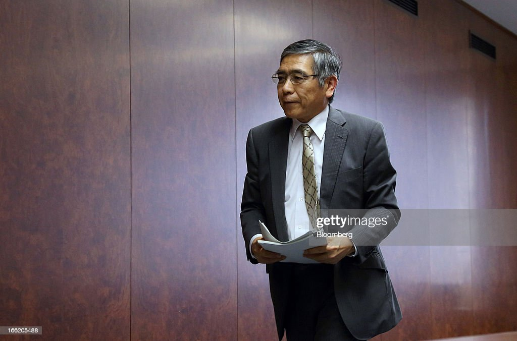 Haruhiko Kuroda, governor of the Bank of Japan (BOJ), leaves a group interview at the central bank's headquarters in Tokyo, Japan, on Wednesday, April 10, 2013. Kuroda said that the central bank will take all measures necessary to meet a 2 percent inflation target even as he indicated policy adjustments are unlikely every month. Photographer: Tomohiro Ohsumi/Bloomberg via Getty Images