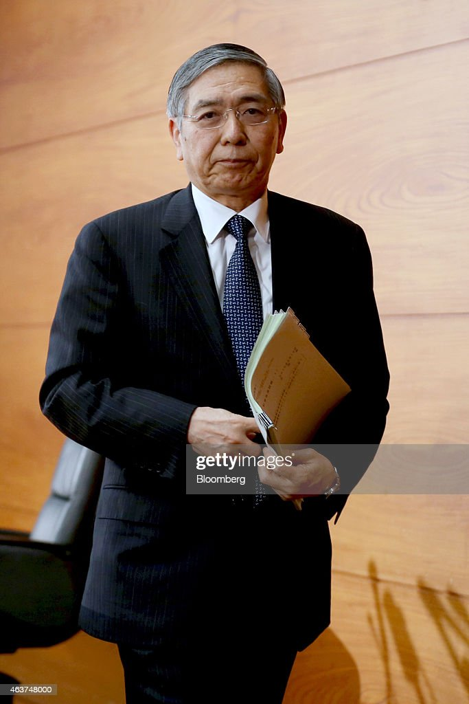 Haruhiko Kuroda, governor of the Bank of Japan (BOJ), leaves a news conference at the central bank's headquarters in Tokyo, Japan, on Wednesday, Feb.18, 2015. Kuroda said he remains on standby to adjust monetary policy if needed after the policy board on Wednesday maintained record stimulus. Photographer: Yuriko Nakao/Bloomberg via Getty Images