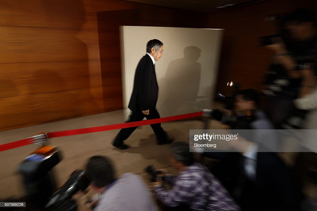 Haruhiko Kuroda, governor of the Bank of Japan (BOJ), leaves a news conference at the central bank's headquarters in Tokyo, Japan, on Friday, Jan. 29, 2016. Kuroda sprung another surprise on investors by adopting a negative interest-rate strategy to spur banks to lend in the face of a weakening economy. Photographer: Tomohiro Ohsumi/Bloomberg via Getty Images