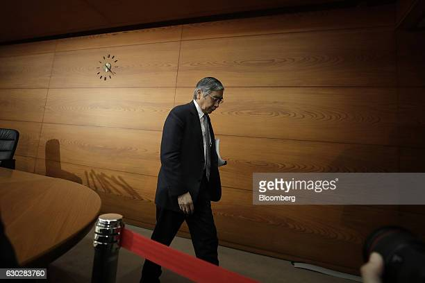 Haruhiko Kuroda governor of the Bank of Japan leaves following a news conference at the central bank's headquarters in Tokyo Japan on Tuesday Dec 20...