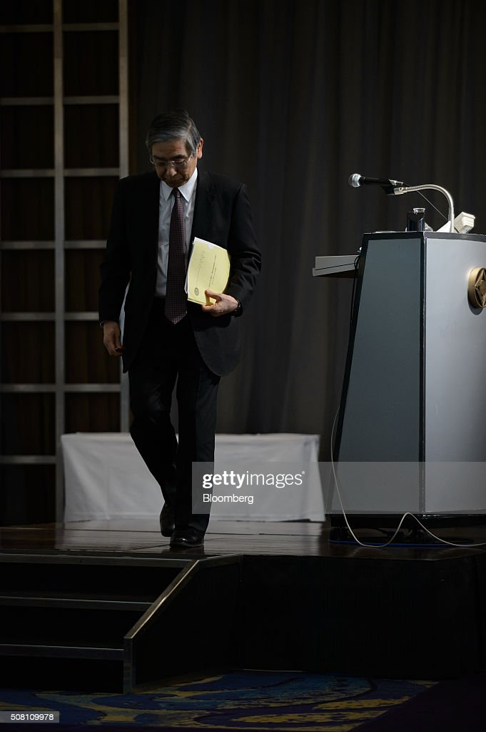 Haruhiko Kuroda, governor of the Bank of Japan (BOJ), leaves the stage after delivering his speech at a meeting hosted by Kyodo News in Tokyo, Japan, on Wednesday, February 3, 2016. Kuroda, in his first public speech after the central bank unexpectedly decided on Jan. 29 to adopt a negative interest rate strategy, said that the BOJ will take additional easing measures if needed. Photographer: Akio Kon/Bloomberg via Getty Images
