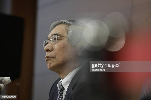 Haruhiko Kuroda governor of the Bank of Japan listens during a news conference at the central bank's headquarters in Tokyo Japan on Tuesday Dec 20...
